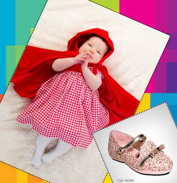 Bebê vestindo capa vermelha